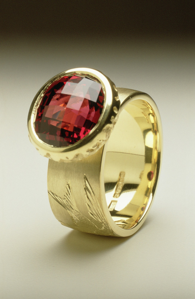 """<a href=""""/jewellery/house-martin-ring-18ct-green-gold-hand-engraved-oval-chequerboard-cut-garnet"""">&#039;House Martin&#039; Ring, 18ct green gold, hand engraved, oval chequerboard cut garnet.</a>"""