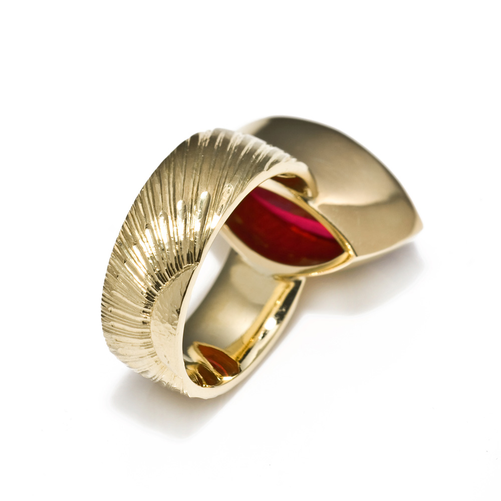 """<a href=""""/jewellery/reverse-detail-2"""">Reverse detail: Dress Ring, 2008. 18 ct gold, shank engraved with rising sun motive. Set with marquise rubelite tourmaline. Photo : Simon Armitt</a>"""
