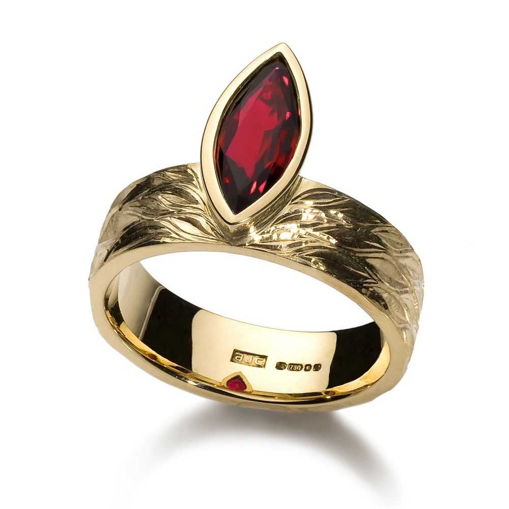 """<a href=""""/jewellery/ring-9"""">Engagement ring, 2008/9. 18 ct yellow gold, ring shank hand engraved, marquise ruby. Photo : Simon Armitt. </a>"""