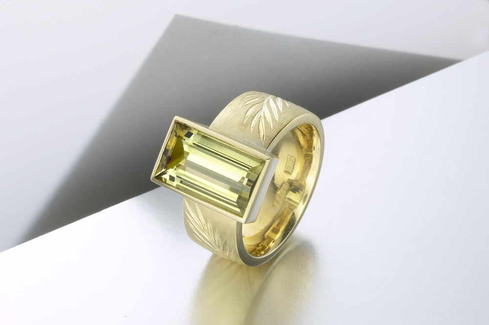 """<a href=""""/jewellery/ring-7"""">&#039;Olive&#039; ring, 18ct yellow gold, hand engraved cut with interlocking olive branches, olive green tourmaline baguette. Photo: Paul Hartley</a>"""