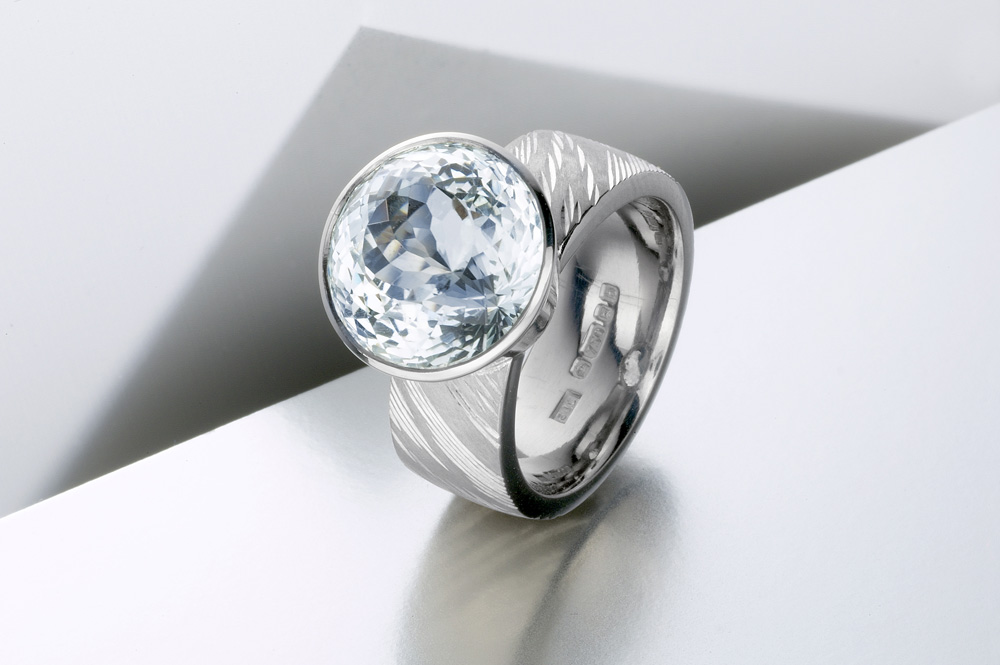 """<a href=""""/jewellery/ring-5"""">&#039;Air&#039; Dress ring, hand engraved, 18ct white gold, royal cut aquamarine. Photo: Paul Hartley</a>"""