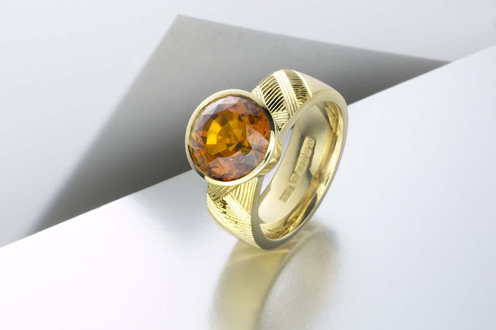 """<a href=""""/jewellery/ring-4"""">&#039;Earth&#039; Dress ring, hand engraved, 18ct yellow gold, brown green tourmaline. Photo: Paul Hartley</a>"""
