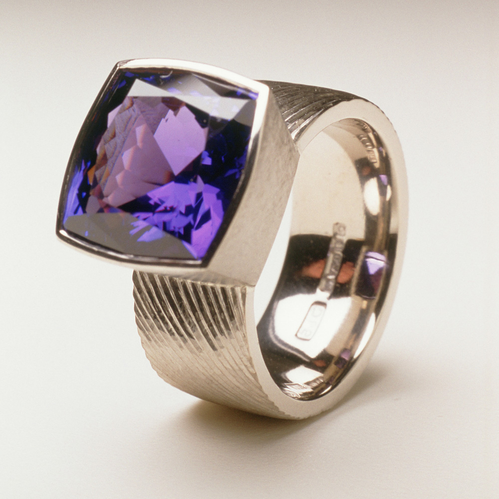 """<a href=""""/jewellery/ring-19"""">Dress ring, 18ct white gold, hand engraved, cushion cut tanzanite, 7.18 cts.</a>"""