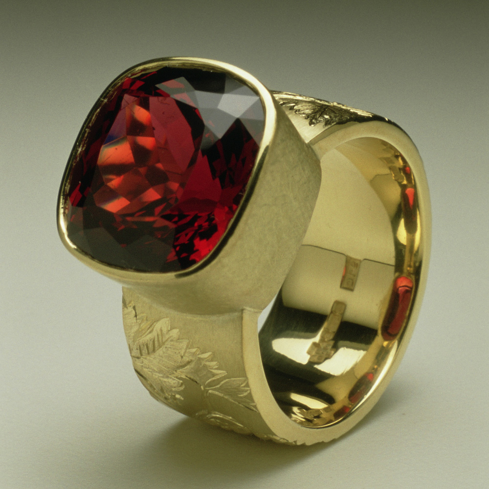 """<a href=""""/jewellery/chianti-dress-ring-commission-cushion-cut-garnet-18ct-yellow-gold-hand-engravers-and"""">&quot;Chianti&quot; Dress Ring, Commission, cushion cut Garnet, 18ct yellow gold hand engravers and carved with vine leaves and grapes</a>"""