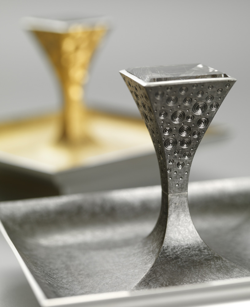 """<a href=""""/jewellery/pair-salts-33-made-silver-pinch-salt-goldsmiths-hall-spring-2009-dishes-88-mm-square"""">Pair of Salts 3/3. Made for &quot;SILVER WITH A PINCH OF SALT&quot; at Goldsmiths Hall Spring 2009. Dishes 88 mm square.. Silver yellow gilding, black rhodium plate, set with pair of square mirror cut rutilated quartz. Setting hand engraved. Photo : courtesy The Go</a>"""
