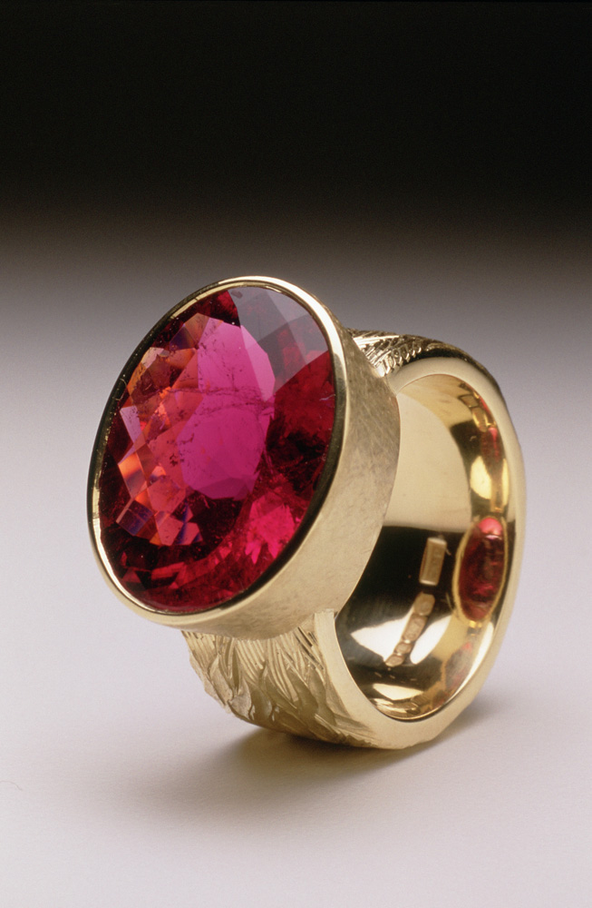 """<a href=""""/jewellery/ring-16"""">&quot;Fire&quot; Dress ring, 18ct yellow gold, hand carved and engraved, red oval chequerboard rubelite tourmaline.</a>"""