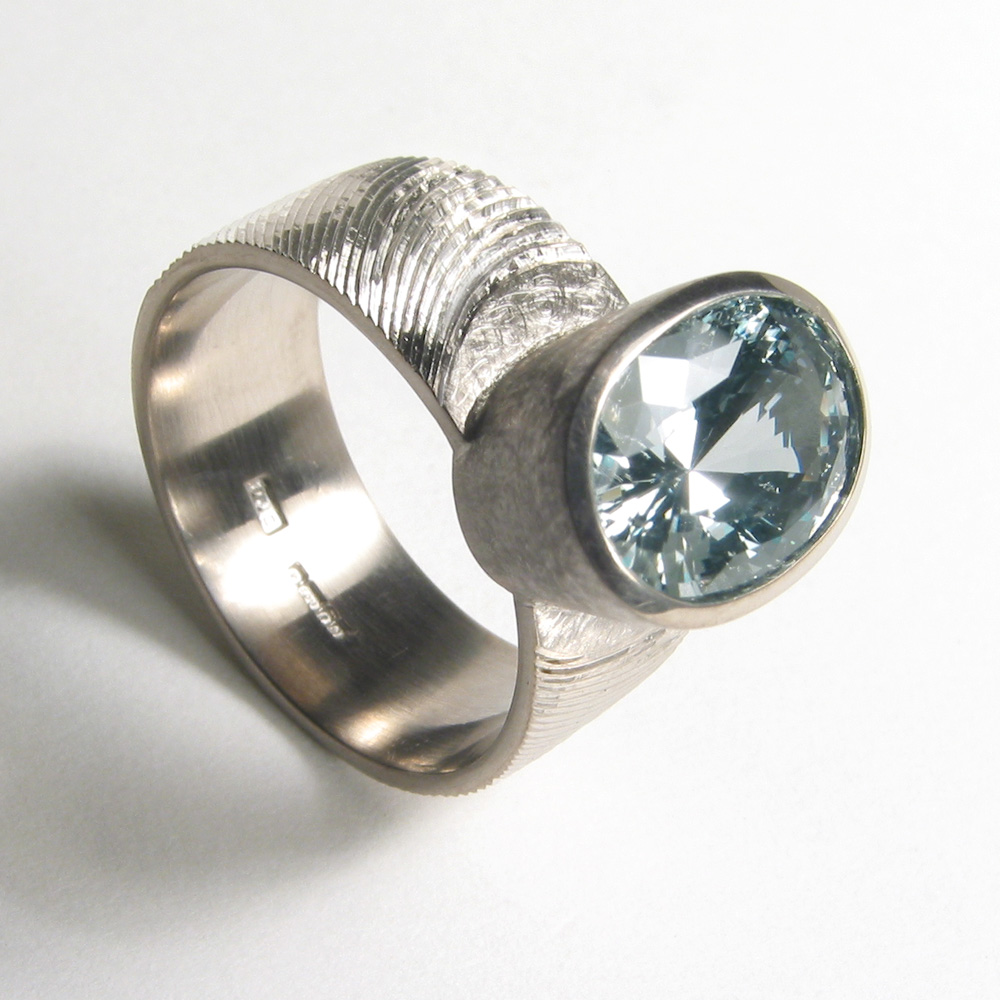 """<a href=""""/jewellery/ring-12"""">Dress ring, 18ct white gold, hand engraved, green sapphire. Photo: Andra Nelki</a>"""