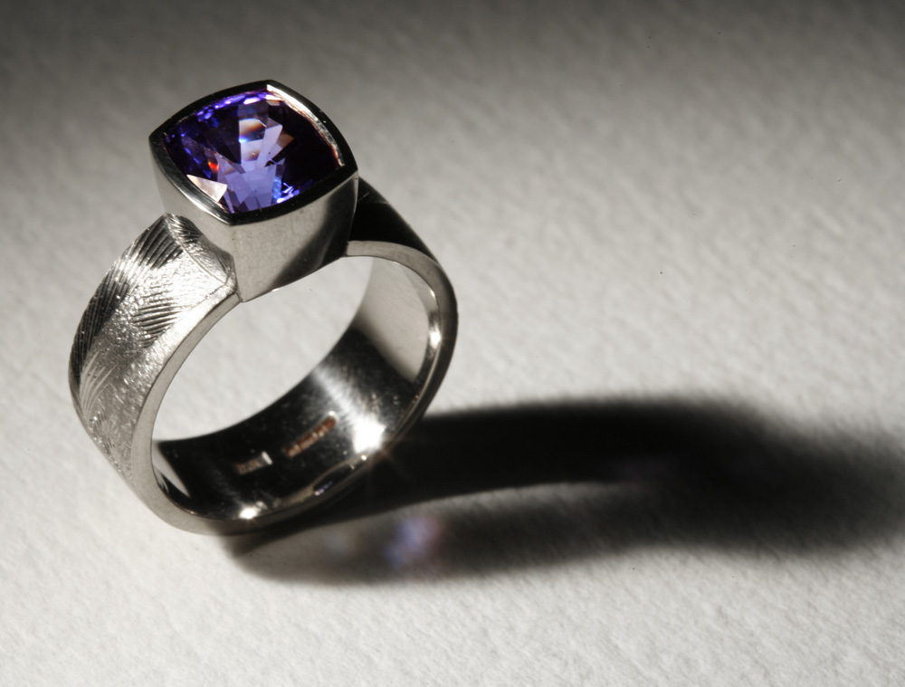"""<a href=""""/jewellery/ring-11"""">Dress ring, 18ct white gold, hand engraved, tanzanite. Photo: Andra Nelki</a>"""