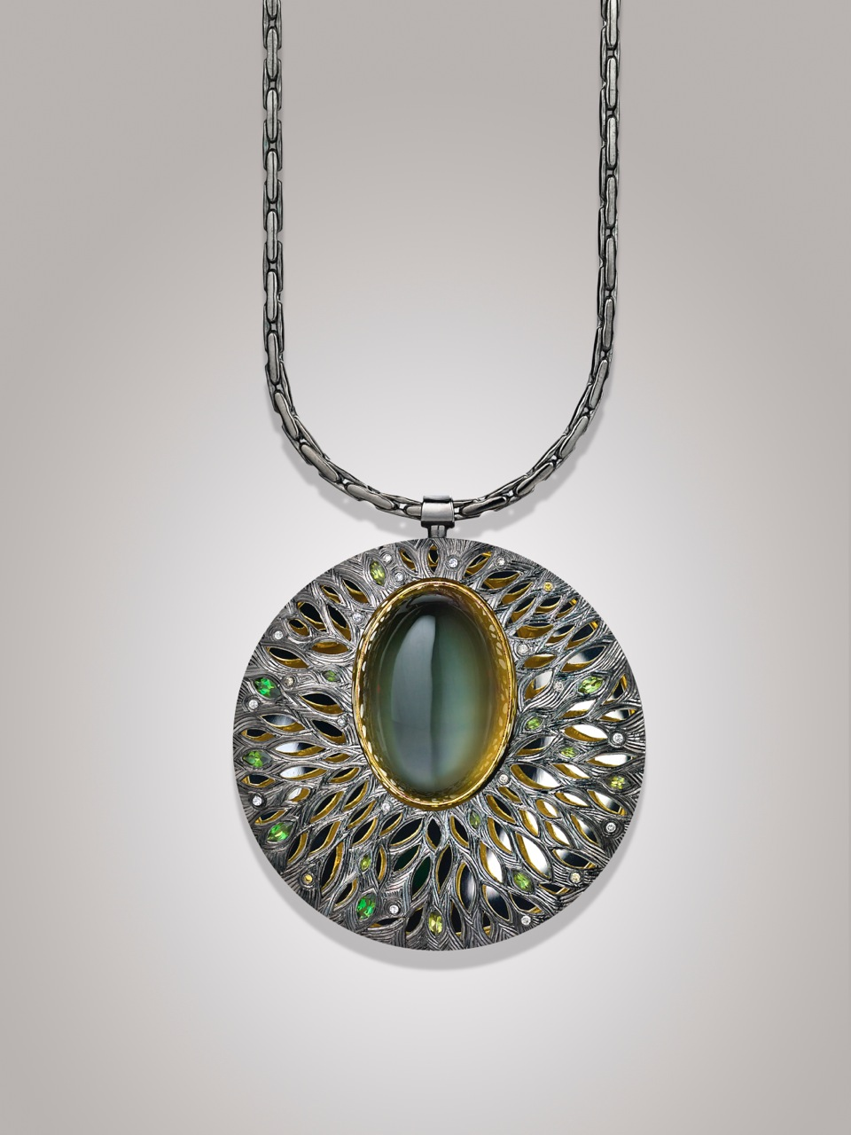 """<a href=""""/node/257""""> &quot;100 Years of Starlight """"   Commission Pendent Silver hand engraved and Pierced / Moonstone set in green gold / green tourmalines / grey diamonds.</a>"""