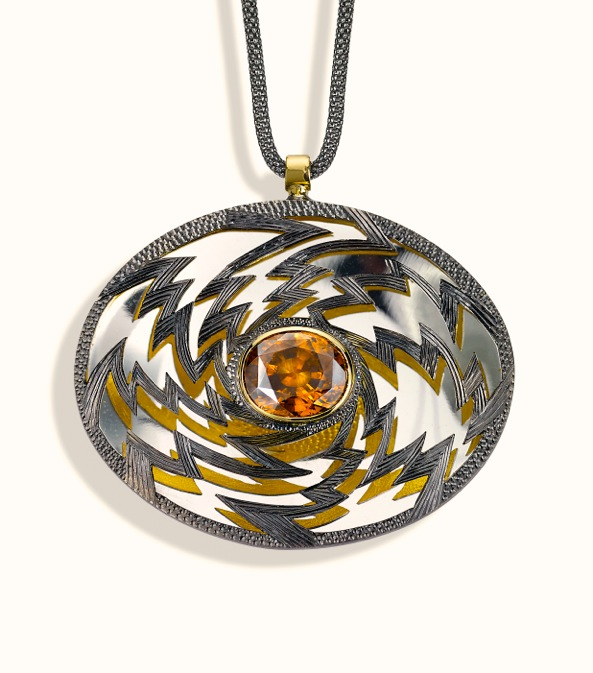 """<a href=""""/node/261"""">PENDENT """"Golden Lightening"""" Oval 6cm x 4 cm. Silver hand engraved, hand pierced, mirror behind to reflect the underside.  Stone oval Zircon in orange / brown. set in 18ct gold.  View 2 Face on light reflections, White background</a>"""
