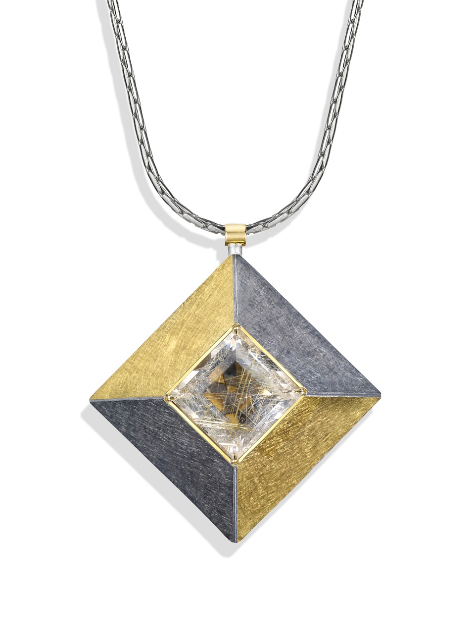 """<a href=""""/node/263"""">Cardinal Points :  Silver 5.0cm square, scrubbed finish finished in Black Rhodium and gilding,  stone setting 18ct gold, stone Rutilated Quartz . View 5 : face on, Close Up - showing unusual relections in the stone.</a>"""