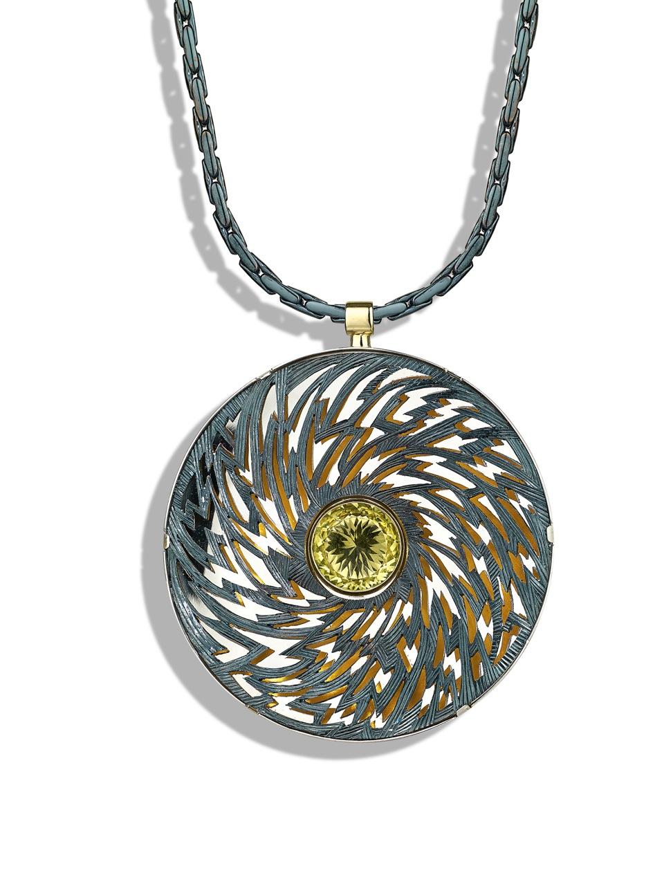 "<a href=""/node/265"">Black Lightening : Billcliffe Gallery cover photo. 6cm diameter. Silver piereced hand engraved. Finished in Bliue / Black Rhodium. Centre stone Lemon Quartz.  View 2 white background.</a>"
