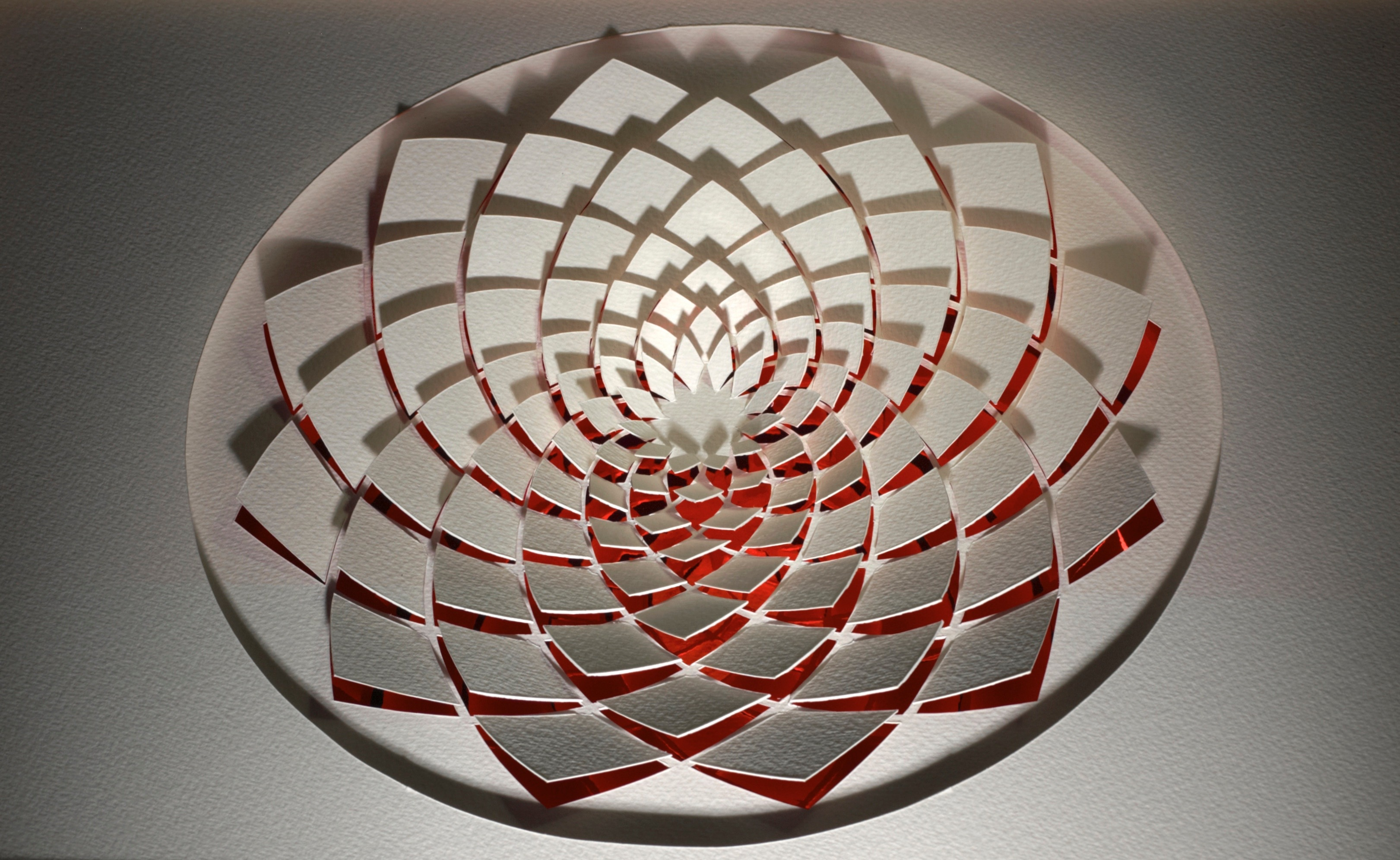"""<a href=""""/node/294"""">Mandala in red and white. Paper Cut / Mandala in red and white """" red metallic mirror board White heavy watercolour paper./ all hand cut with a scalpel.</a>"""