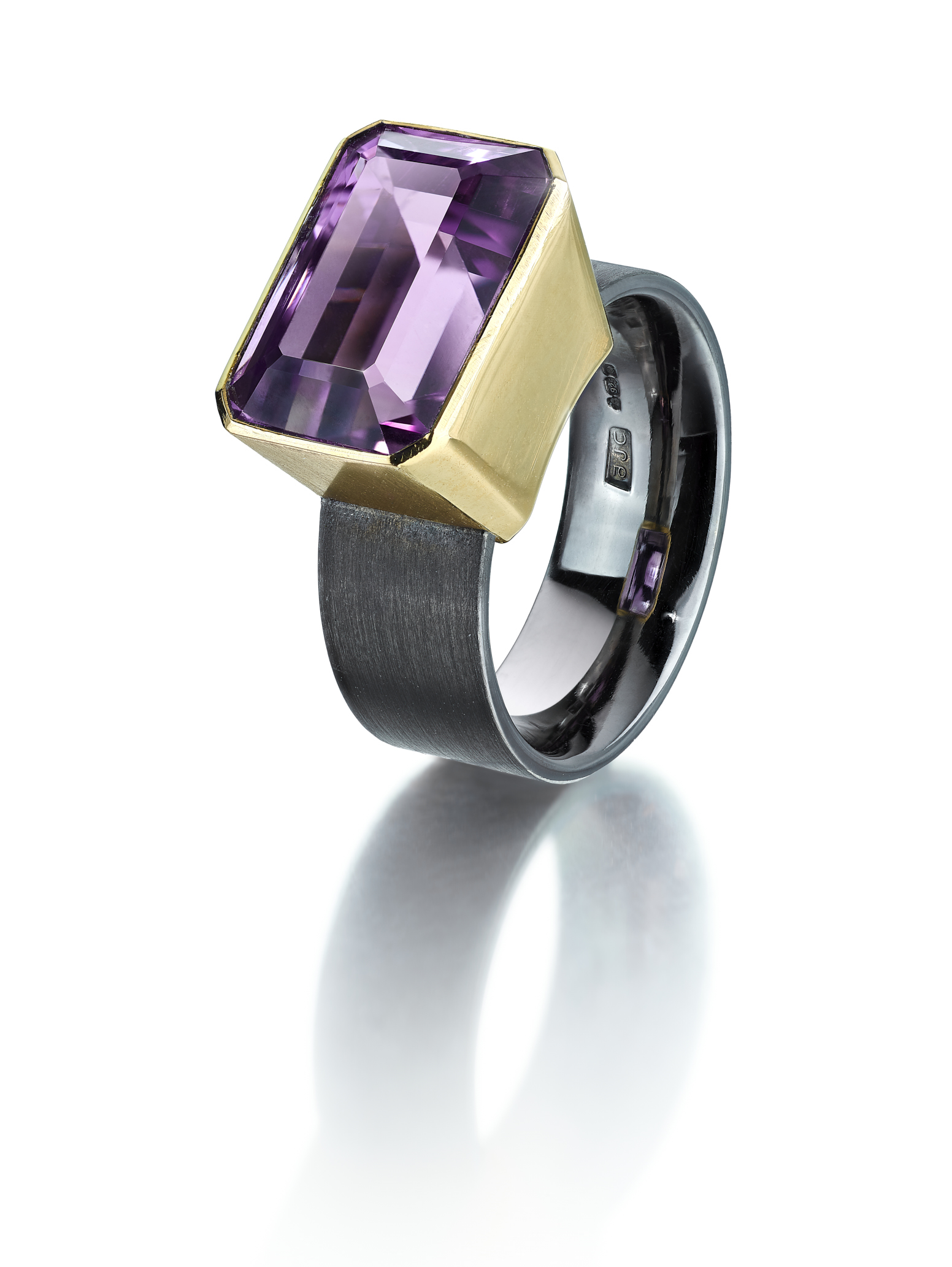 """<a href=""""/node/291"""">Amethyst Dress Ring size Q. Fine Pale Amethyst set in 18ct gold / Ring shank brushed on the outside and polished inside finished in black rhodium. Photo : Simon B Armitt</a>"""