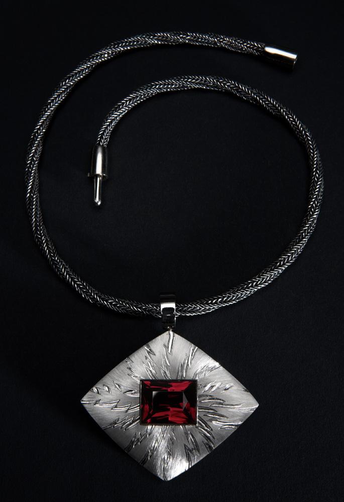 "<a href=""/jewellery/alchemy-pendant-photo-12-18-ct-white-gold-rectangular-garnet-1877-cts-face-piece-hand"">&quot;ALCHEMY&quot; PENDANT photo 1/2. 18 ct White Gold, rectangular Garnet 18.77 cts. Face of piece Hand Engraved, carved and striated, wd 6.0 cm x ht 6.0 cm overall. Photo: Simon Armitt</a>"