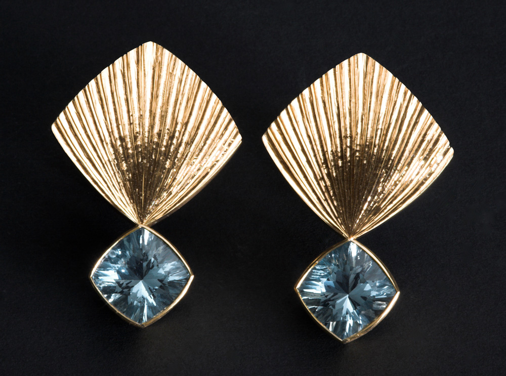 """<a href=""""/jewellery/earrings-18ct-yellow-gold-hand-engraved-set-pair-laser-cut-aquamarines-clip-and-post"""">Earrings 18ct yellow Gold, hand engraved. Set with pair of laser cut Aquamarines. Clip and Post fittings. Size of earring tops 20mm square. Photo Simon Armitt </a>"""