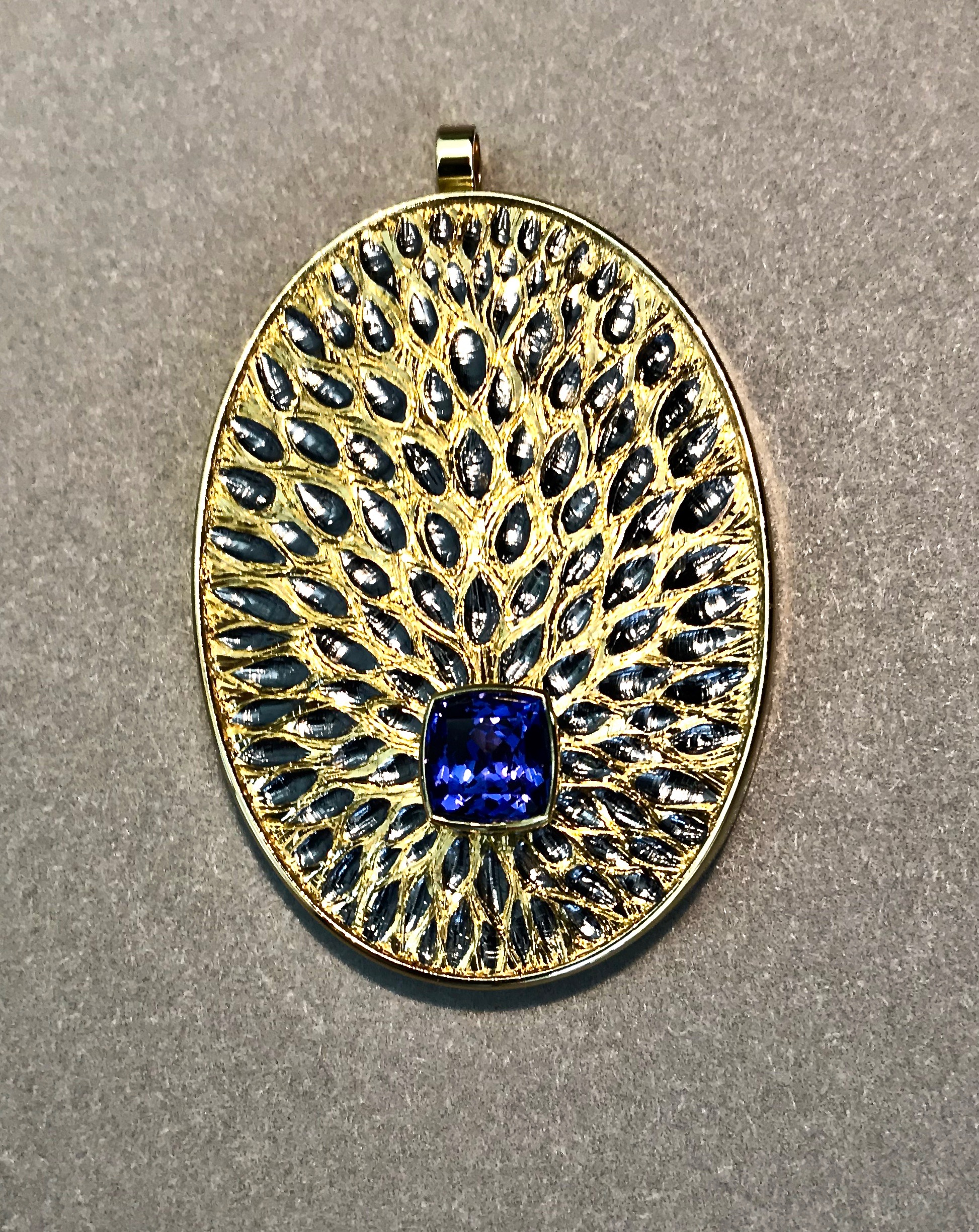 """<a href=""""/node/287"""">Peacock with a fiery tail. Tanzanite / 18ct gold / Silver / Hand Engraved / gilded and rhodium plate</a>"""