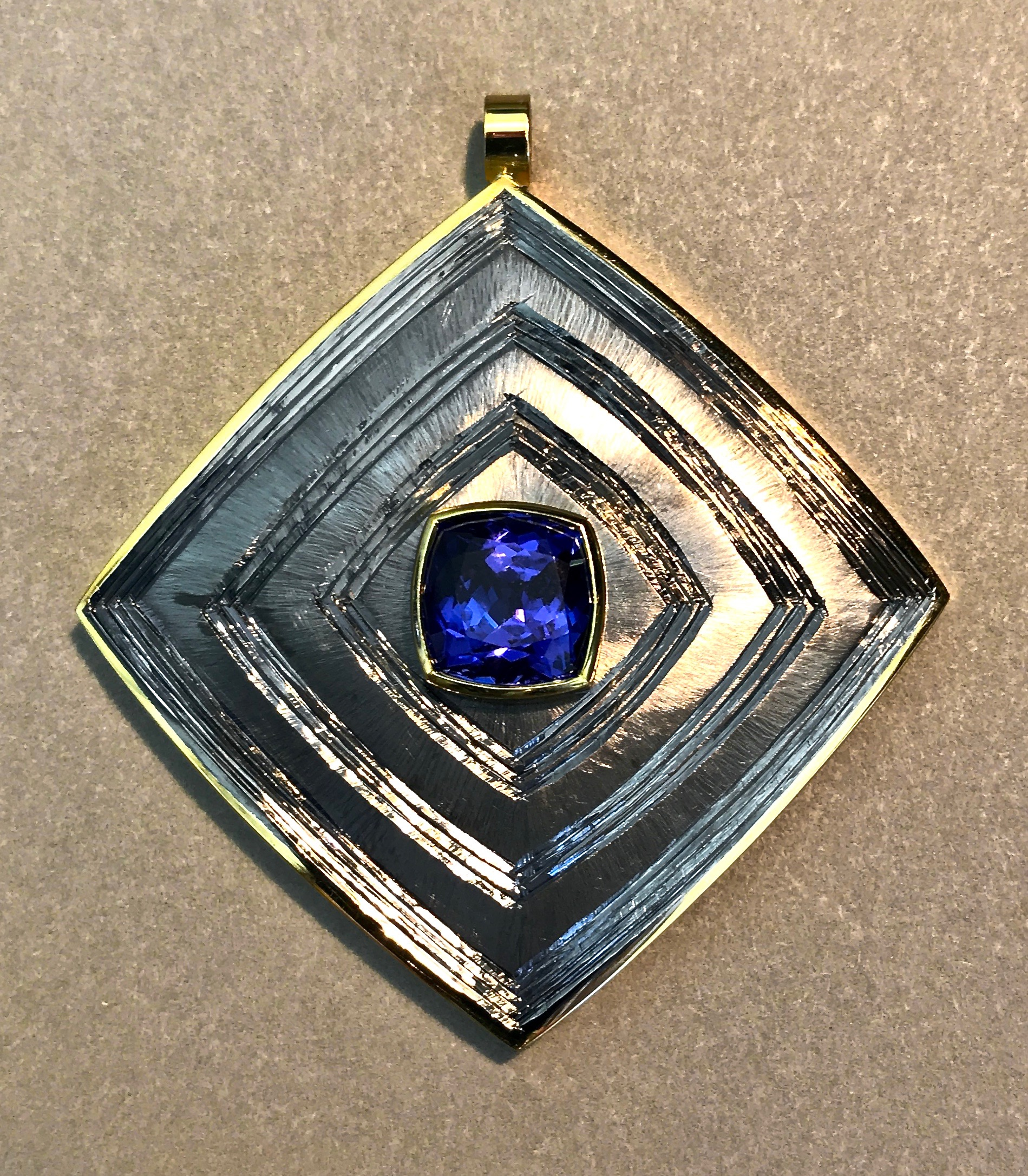 """<a href=""""/node/288"""">Square Dance. Tanzanite / 18ct gold / Silver / Hand Engraved / gilded and rhodium plate </a>"""