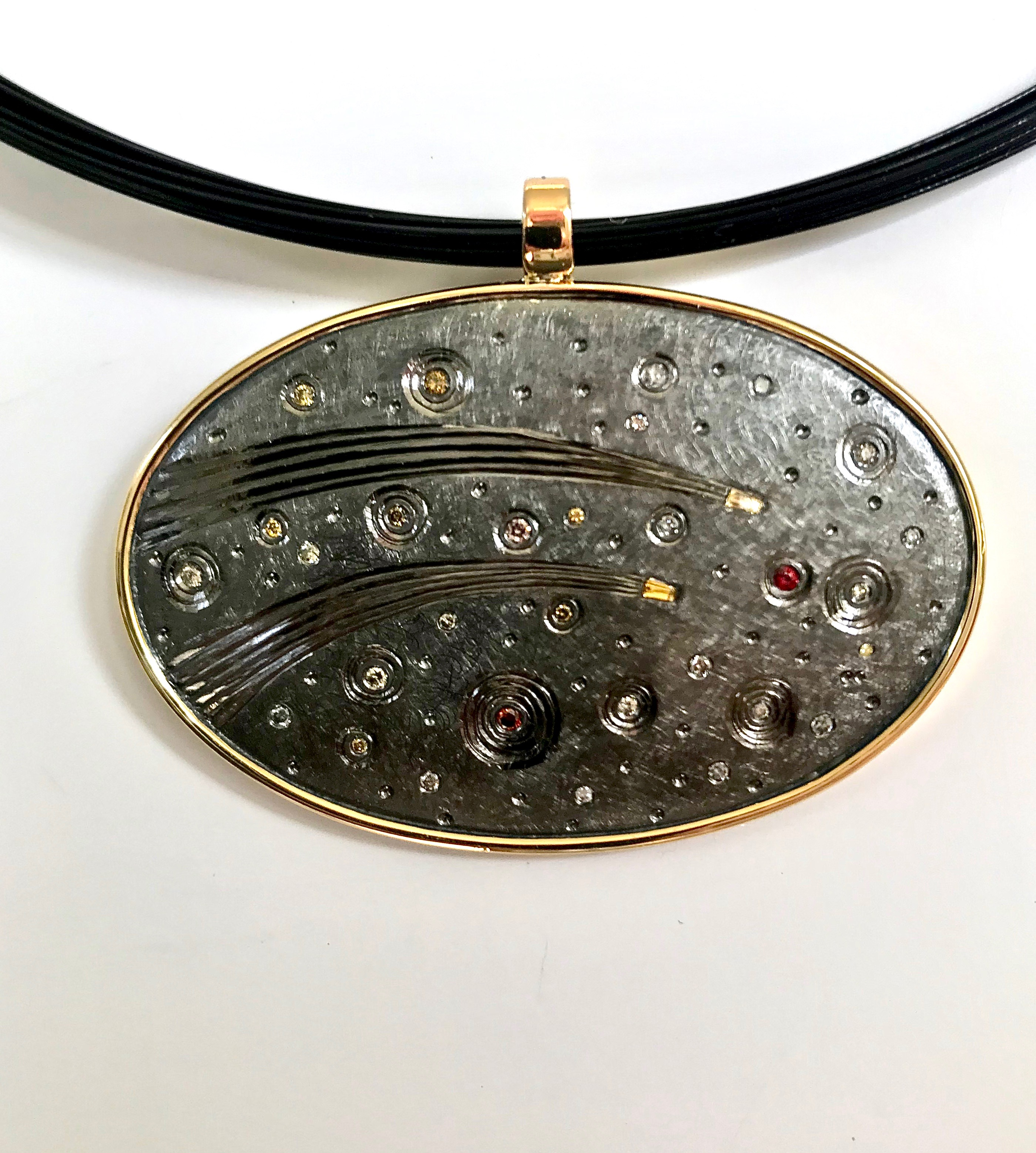 """<a href=""""/node/289"""">Two Comets. Recent Commission 50 th wedding anniversary / pendent drop 18ct gold / Silver / hand engraved / set with various coloured diamonds /finished in black Rhodium plate</a>"""
