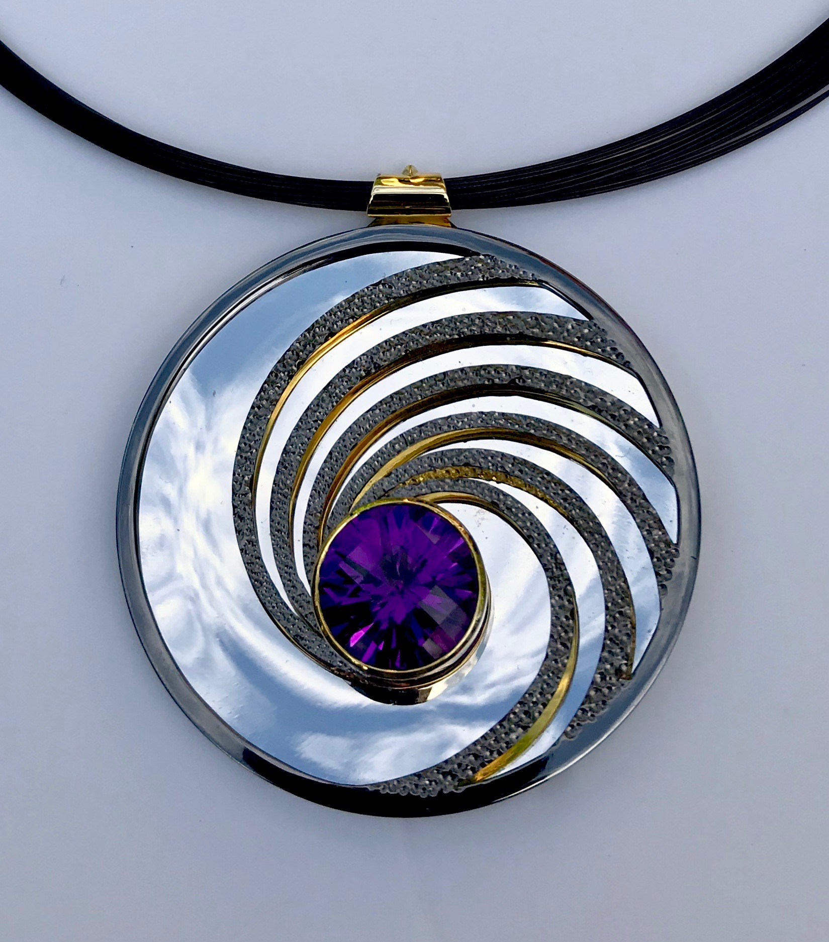 """<a href=""""/node/295"""">Swinging on a Star. Dark Amethyst / Silver / Part Gilded part Rhodium Plate / the mirror on the inside back will reflect whatever its facing - here it's the Sky.</a>"""