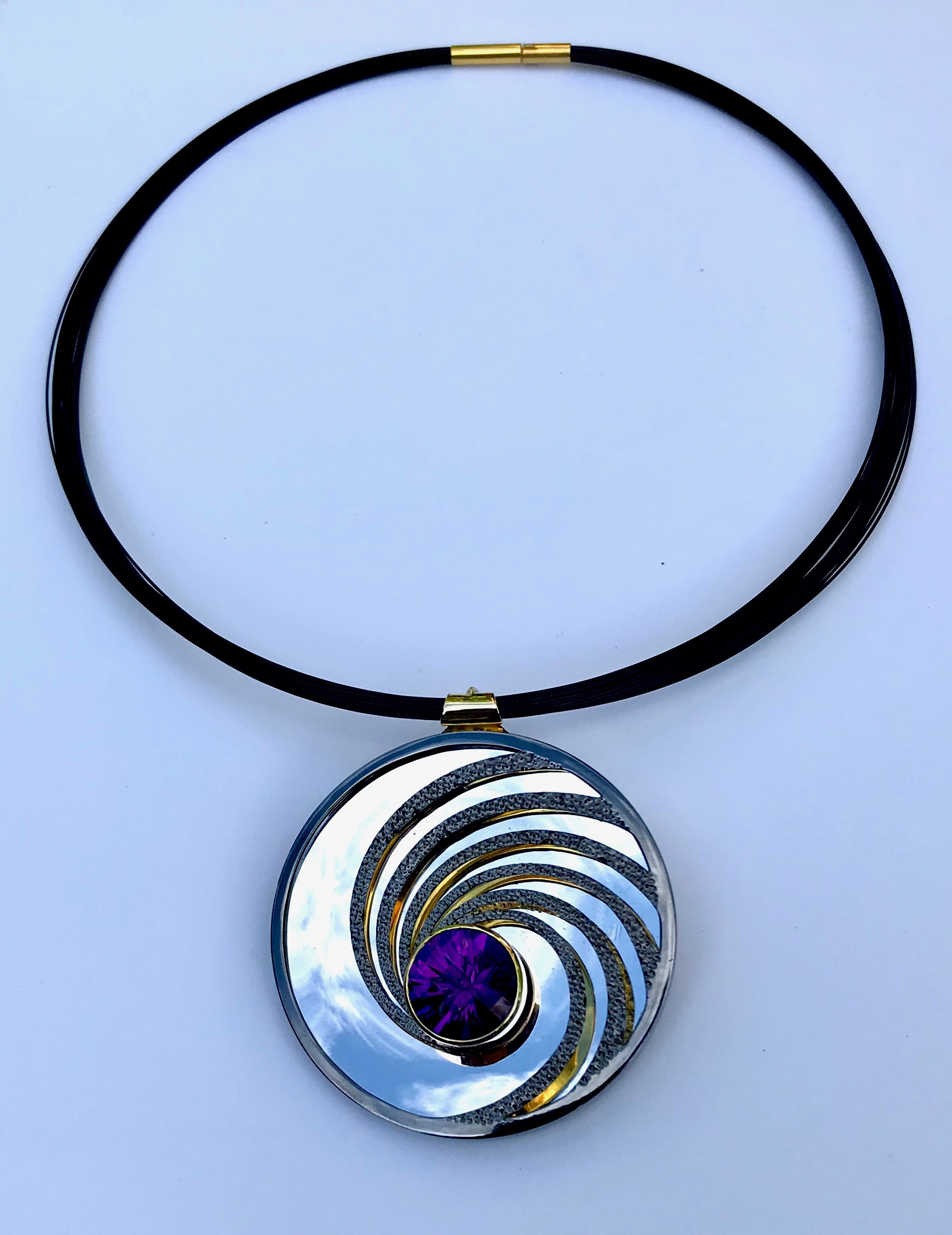 """<a href=""""/node/296"""">Swinging on a Star. Dark Amethyst / Silver / Part Gilded part Rhodium Plate / the mirror on the inside back will reflect whatever its facing - here it's the Sky.</a>"""