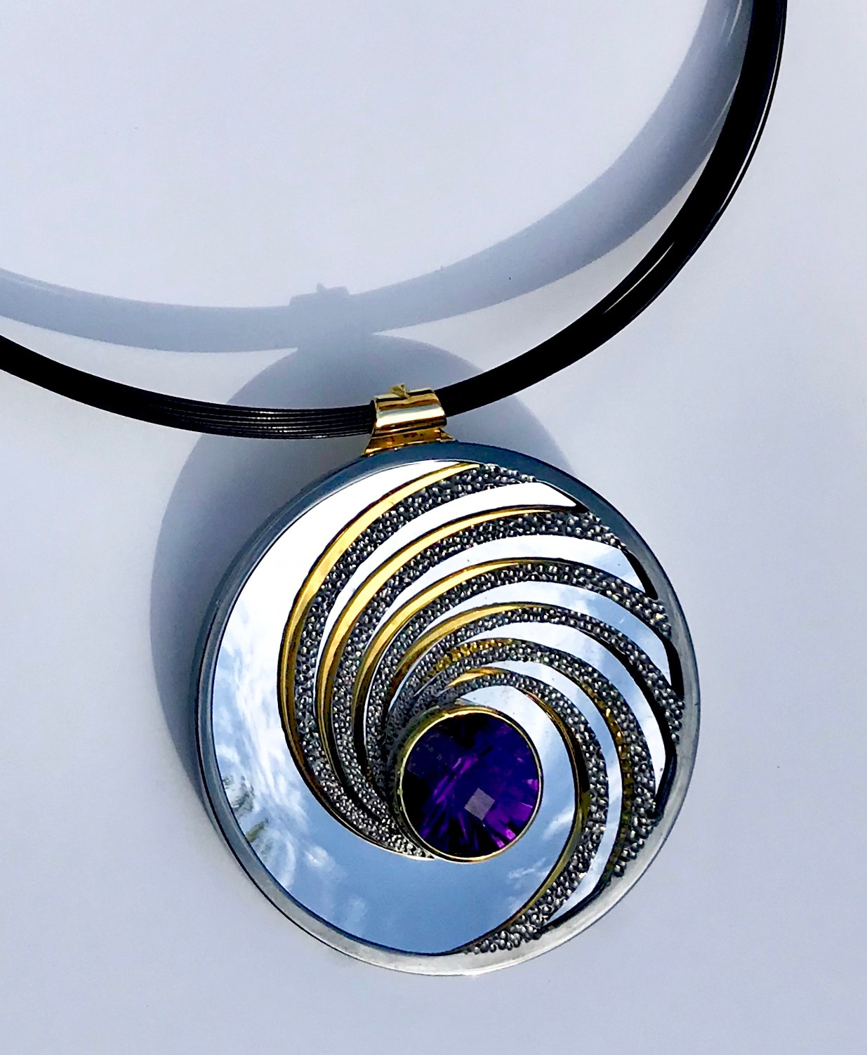 """<a href=""""/node/297"""">Swinging on a Star. Dark Amethyst / Silver / Part Gilded part Rhodium Plate / the mirror on the inside back will reflect whatever its facing - here it's the Sky.</a>"""