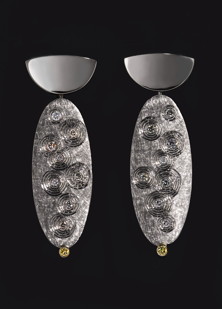 """<a href=""""/jewellery/earrings-en-suite-golden-thread-brooch-18ct-white-gold-set-grey-diamonds-and-small-pair"""">EARRINGS En Suite with &quot;GOLDEN THREAD BROOCH&quot;. 18ct white gold, set with grey diamonds and small pair yellow diamomds. 2008. Photo: Simon Armitt</a>"""