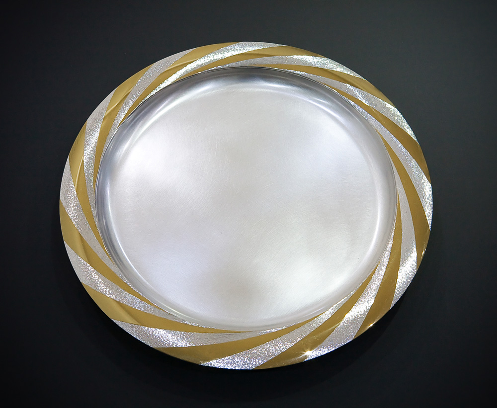 """<a href=""""/jewellery/sun-platter-october-2008-silver-rim-hand-engraved-and-polished-part-gilded-36-cm-diameter"""">SUN PLATTER. October 2008. Silver, rim hand engraved and polished part gilded. 36 cm diameter. Photo : Simon Armitt</a>"""