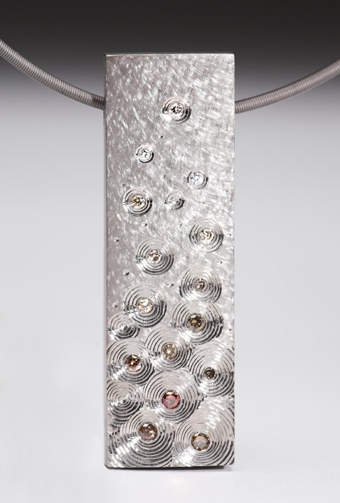 """<a href=""""/jewellery/pendant-18-ct-white-gold-set-sepia-coloured-fading-white-diamonds-ht-50-cm-x-wd15-cm"""">Pendant 18 ct white gold Set with sepia coloured / fading to white diamonds. ht 5.0 cm x wd1.5 cm. Titanium chain</a>"""