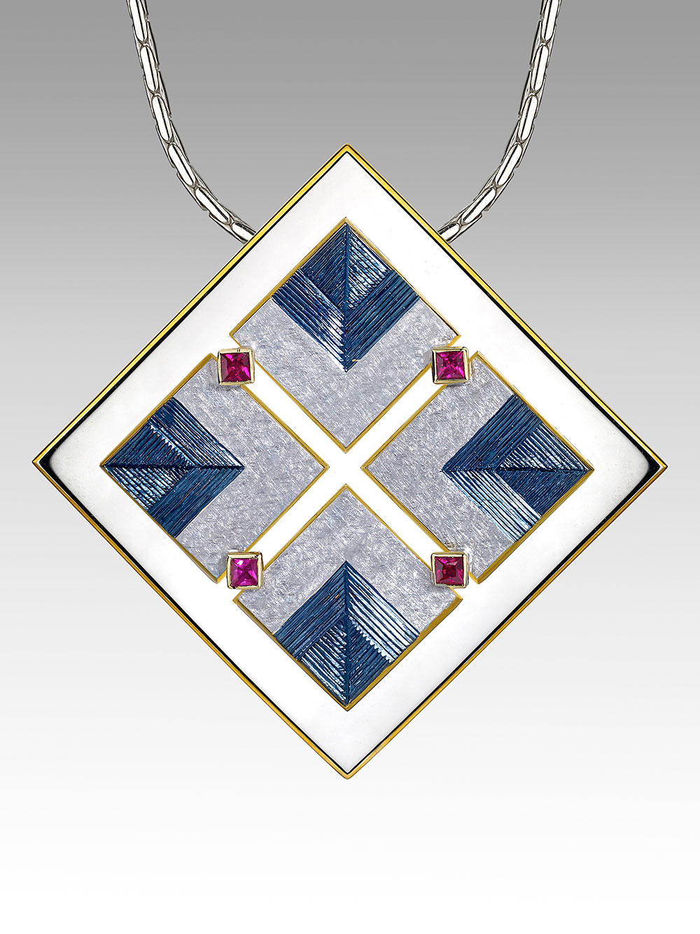 """<a href=""""/node/267"""">""""PENDENT OF THE GOLDEN WORLDS""""  Silver and 18ct gold, Gilding and Rhodium plate in various colours / Hand Engraved / Set with 4 square red Spinels photo : Simon B Armitt 2017</a>"""