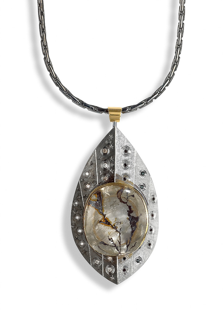 """<a href=""""/jewellery/pendent-untitled-silver-finished-white-and-black-rhodium-part-gilded-hand-engraved-set"""">Pendent ( Untitled ) Silver finished in white and black rhodium, part gilded. Hand Engraved. Set with black and brown diamonds, Landscape quartz.  Photo : Simon B Armitt</a>"""