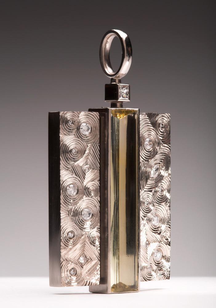"<a href=""/jewellery/kimono-pendant-photo-22-commission-18ct-white-gold-set-clients-re-cycled-diamonds-centre"">&quot;KIMONO&quot; Pendant photo 2/2. Commission, 18ct white gold, set with clients re-cycled diamonds, centre stone pale yellow Beryl baguette. 5.0 cm ht x 2.8 cm wd. Photo Simon Armitt.</a>"