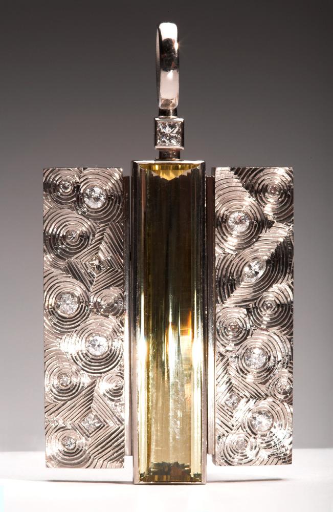 "<a href=""/jewellery/kimono-pendant-photo-12-commission-18ct-white-gold-set-clients-re-cycled-diamonds-centre"">&quot;KIMONO&quot; Pendant photo 1/2. Commission, 18ct white gold, set with clients re-cycled diamonds, centre stone pale yellow Beryl baguette. 5.0 cm ht x 2.8 cm wd. Photo Simon Armitt.</a>"