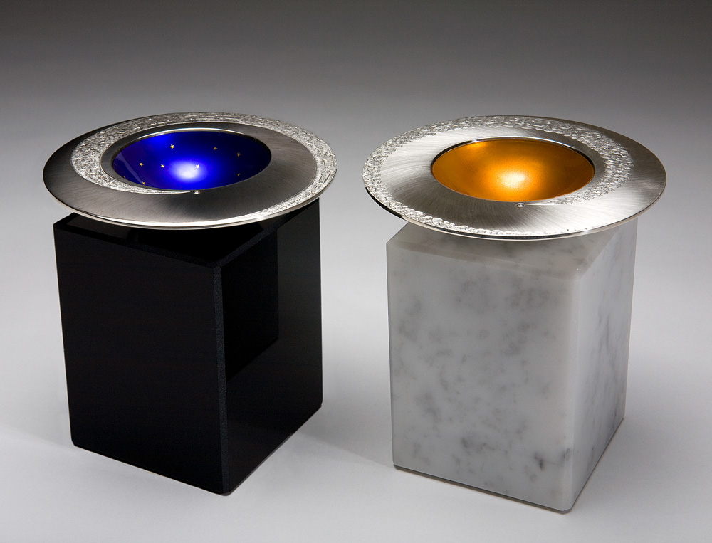 """<a href=""""/jewellery/spinning-comet-bowls-day-night-2009-silver-hand-engraved-enamel-and-gold-leaf-bases-black"""">SPINNING COMET BOWLS - DAY &amp; NIGHT. 2009, Silver, hand engraved, enamel and gold leaf. Bases in black obsidian and white marble. Bowls 110 mm diam, bases 7.5 x 7.5 x 10 cm. Photo : Simon B Armitt.</a>"""