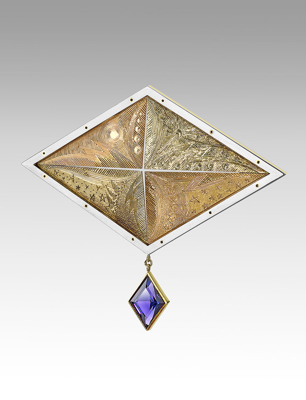 """<a href=""""/node/268"""">""""STAR OF WONDER"""" Produced 1991 !8ct white / green / red /  yellow golds / Hand Engraved / Lozenge cut Amethyst  photo : Simon B Armitt 2017</a>"""