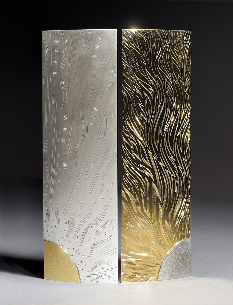 """<a href=""""/jewellery/sol-luna-vases-23-pair-triangular-vases-silver-hand-engraved-yellow-and-black-gilding-made"""">SOL &amp; LUNA VASES 2/3. Pair of triangular Vases. Silver, hand engraved, yellow and black gilding. Made 2010, ht. 30 cm. Photo : Simon B Armitt.</a>"""