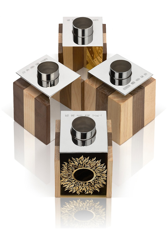 """<a href=""""/jewellery/reflection-candelholders-reflection-candleholders-design-alan-craxford-two-pairs-each-cube"""">Reflection Candelholders Reflection Candleholders Design by Alan Craxford.  Two pairs Each cube 5.5cm square. Silver finished in grey rhodium, part hand engraved, part gilded. Wood  English Walnut and Maple.</a>"""