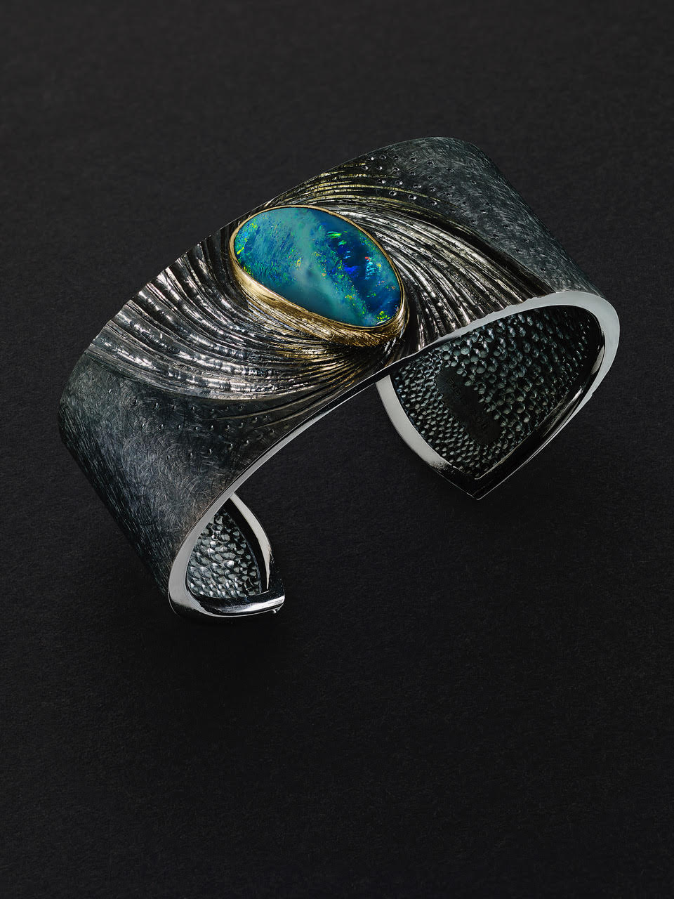"""<a href=""""/node/278"""">NewsCuff : Silver, hand engraved and black rhodium plated, Australian Opal set in 22 ct gold</a>"""