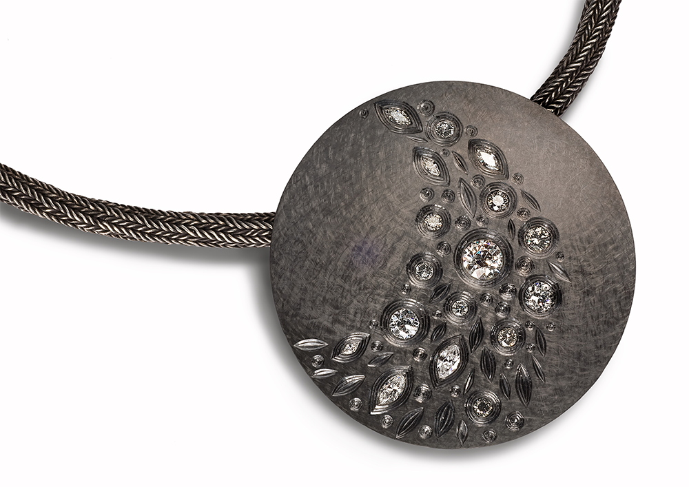 """<a href=""""/jewellery/night-falling-stars-pendent-2008-9-60-mm-diam-silver-hand-engraved-finished-black-rhodium"""">NIGHT OF THE FALLING STARS PENDENT 2008 / 9. 60 mm diam silver hand engraved finished in black rhodium, set with various white grey, brilliant, marquise and old cut diamonds. photo : simon b armitt.</a>"""