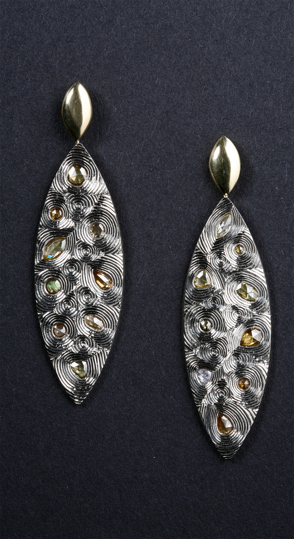 """<a href=""""/jewellery/18ct-yellow-and-white-gold-hand-engraved-white-and-coloured-diamonds-photo-andra-nelki"""">18ct yellow and white gold, hand engraved, white and coloured diamonds. Photo: Andra Nelki</a>"""