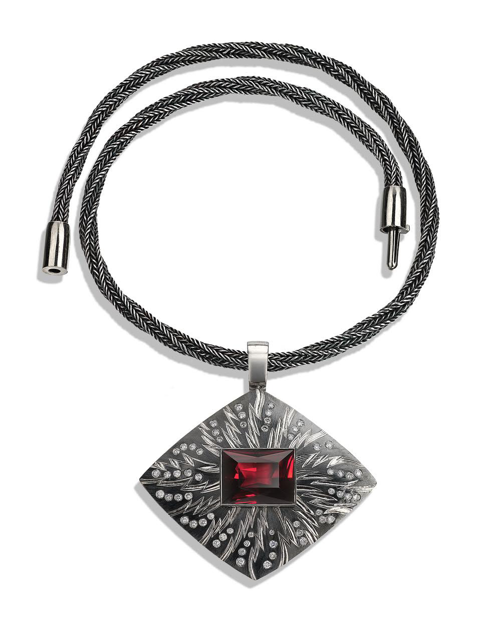 """<a href=""""/node/277"""">""""PORTAL"""" Pendent; 18ct white gold, hand engraved and carved, Set with 58 grey diamonds / rectangular Garnet 18.77cts. Part coloured in Black Rhodium. Hand knitted """" Sacred Knot"""" chain in fine silver oxidised black' White Gold clasp / can be worn separatel</a>"""