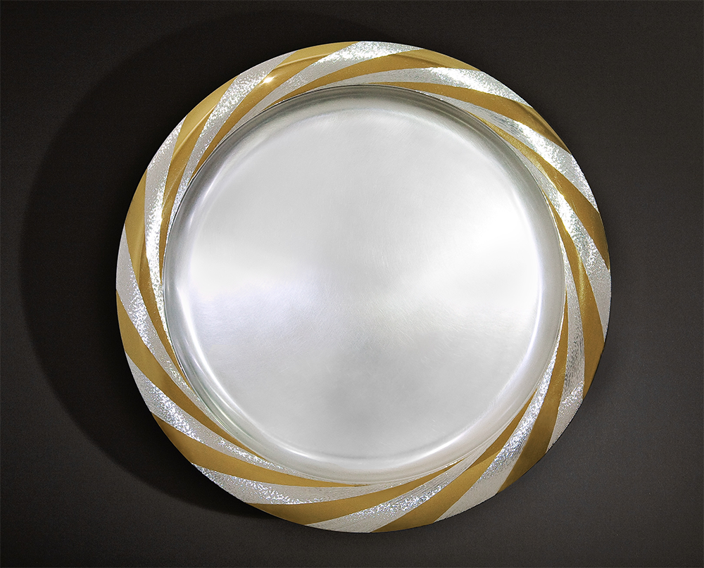 """<a href=""""/jewellery/sun-platter-commission-diwali-october-2008-silver-rim-hand-engraved-and-polished-part"""">SUN PLATTER - COMMISSION FOR DIWALI, October 2008 Silver, rim hand engraved and polished part gilded 36 cm diameter Photo : Simon B Armitt</a>"""