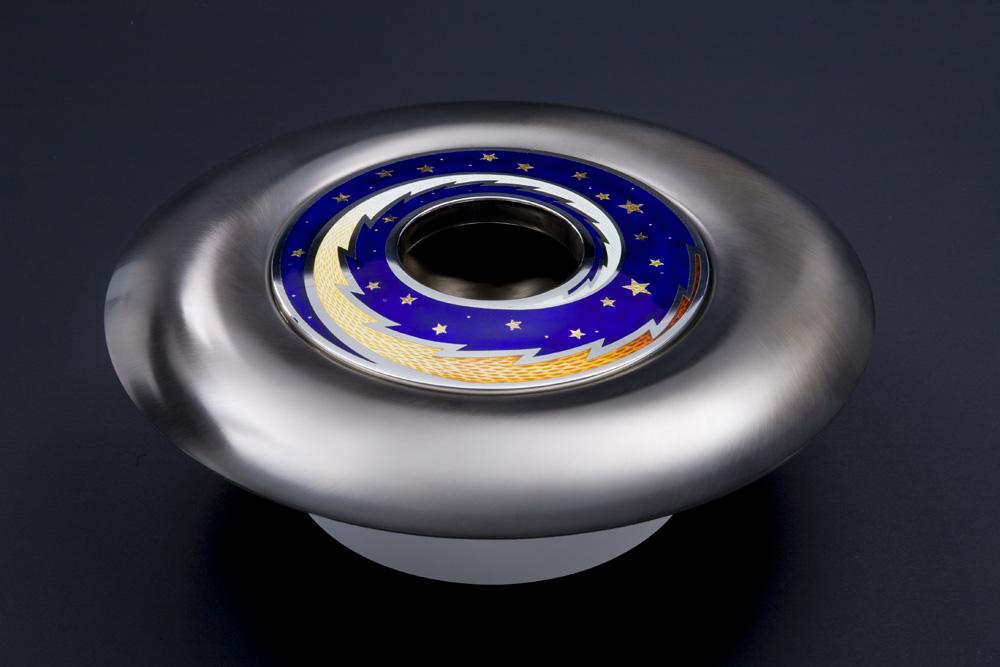 "<a href=""/jewellery/angle-view-spinning-pomander-source-love-2008-silver-enamel-black-gilding-optical-quartz"">Angle view: SPINNING POMANDER : &quot;SOURCE OF LOVE&quot; 2008. Silver, enamel, black gilding, optical quartz base. 30cm diam. Photo: Simon Armitt</a>"