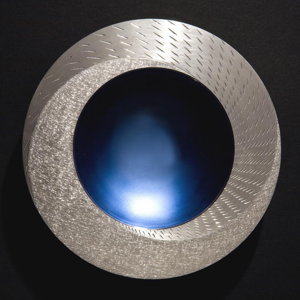 "<a href=""/jewellery/rain-spinning-bowl-2008-150-mm-diameter-brittannia-silver-moonstone-blue-enamel-white"">RAIN SPINNING BOWL 2008. 150 mm diameter. Brittannia Silver, Moonstone Blue enamel, white marble. Photo: Simon Armitt</a>"