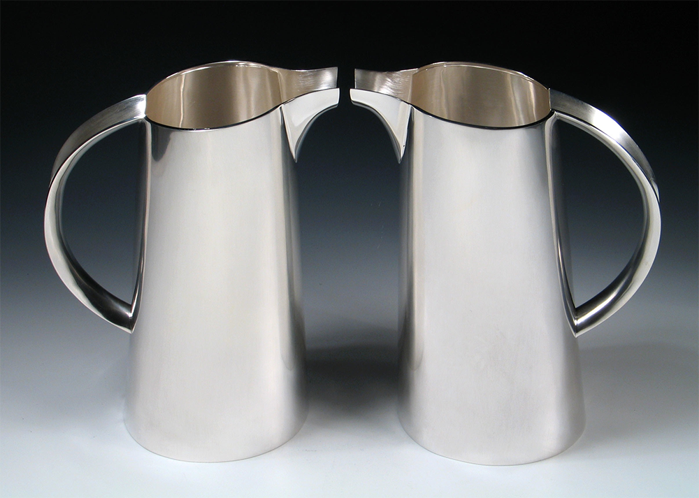 """<a href=""""/jewellery/pair-water-jugs-commission-silver-photo-andra-nelki"""">Pair of water jugs. Commission, silver. Photo: Andra Nelki</a>"""